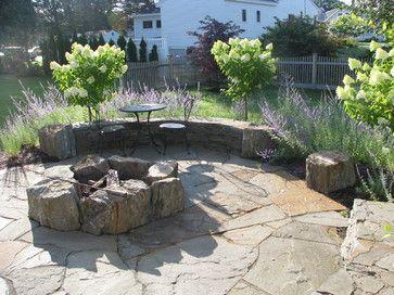 rustic boulder fire pit on flagstone patio - portland maine - Atlantic Landscape & Design, Inc.
