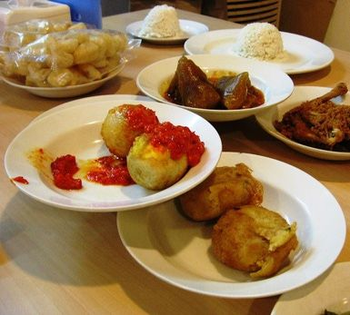 Cow Brains! And Other Surprises at a Nasi Padang Restaurant: Little platters of food at Sari Bundo Padang restaurant