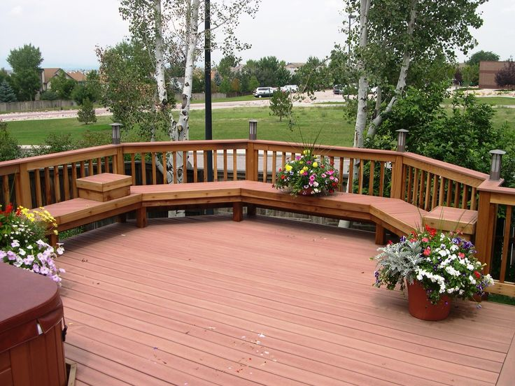 Merveilleux Brown Wooden Patio Deck With Curved Brown Wooden Bench And Railing Plus  Colorful Flower On Brown Pot. Enchanting Patio Deck Ideas Brings  Mesmerizing Looks
