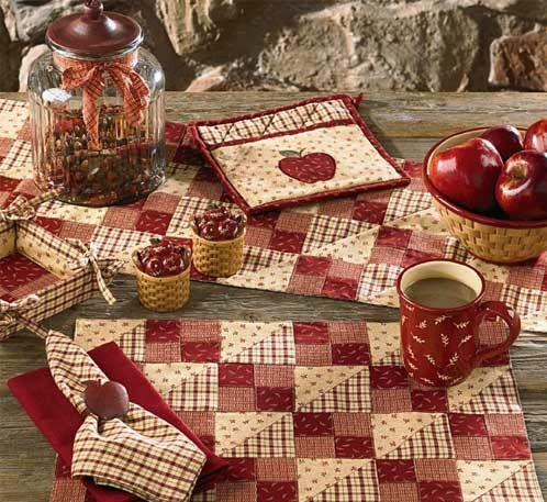 """Apple Jack country reds and cream placemats 6 for $53.70 Table runner 36"""" $22.95 for the Breakfast/ Kitchen table"""
