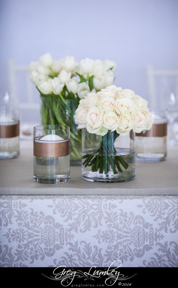 White roses for wedding table decor at Lourensford Wiine Estate.  Demask table cloth.