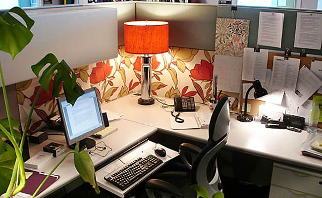 An Upgrade in Cubicle Decor Can Enhance Your Working Life  I like the personalization and warm glow added by the lamp
