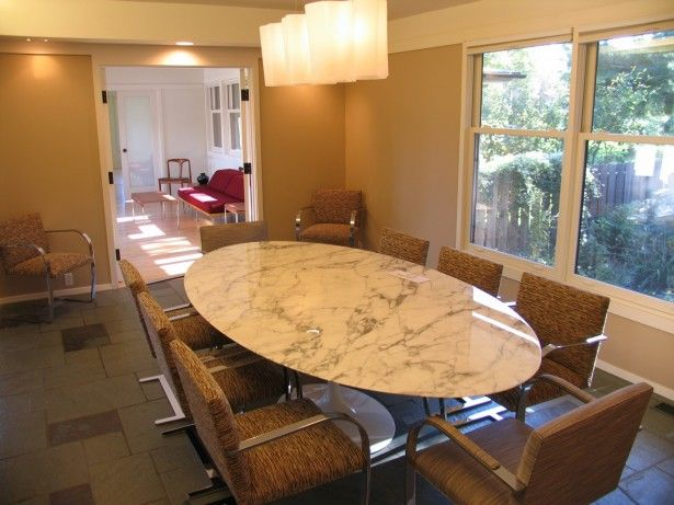 Luxurious Oval Marble Dining Table Feat Brown Chairs Plus Beautiful Pendant Lamps