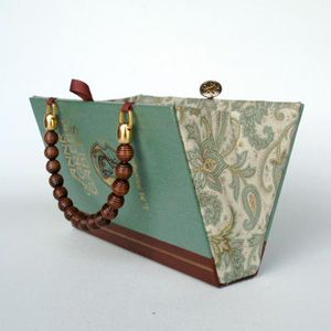 Transform a beautiful hardcover into a book purse.