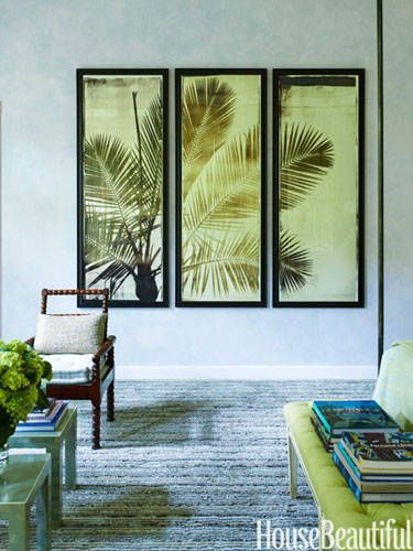 A large photo triptych adds a tropical spirit to subdued glazed walls in a Naples, Florida home designed by Jesse Carrier and Mara Miller.