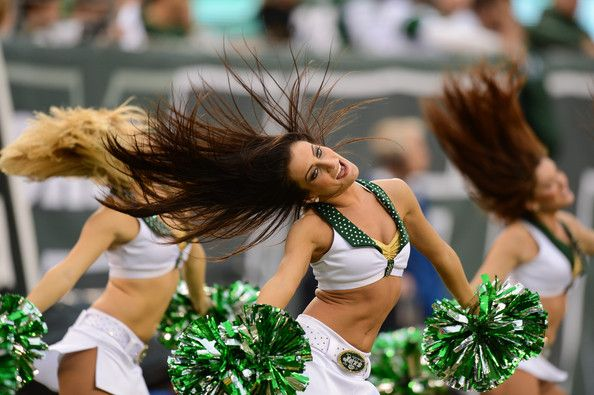 New York Jets cheerleaders perform during the first half of the game against the Cleveland Browns at MetLife Stadium on December 22, 2013 in...