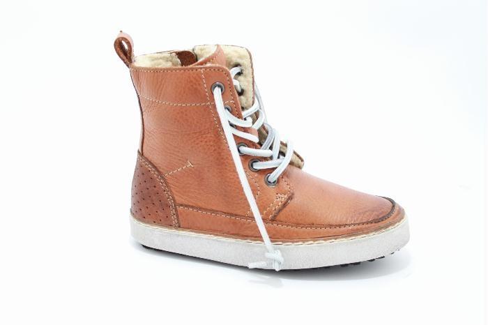 Hoog veter schoen met een rits, van het merk Blackstone.  Cognac leer, bontgevoerd behalve de zool