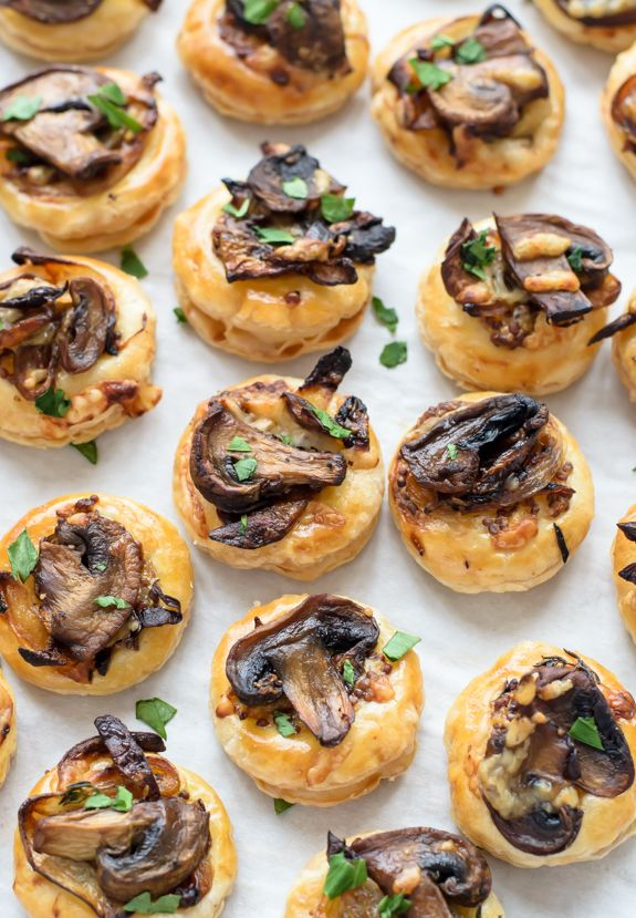 These Cheesy Mushroom Puff Pastry Bites are an awesome appetizer recipe to make for your next get-together with friends! Savory and soft, these bite-sized starters are sure to please the whole crowd!