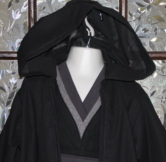 Wouldnt your next generation Star Wars fan look adorable in this Sith or Dark Jedi inspired costume. This outfit is perfect for any Star Wars fan for dress up play or for that theme park or convention visit. The hooded robe is made in black 100% premium cotton broadcloth and the black leggings are made with soft cotton/polyester knit. The robe is ankle length and has long sleeves. The seam along the back of the hood is enclosed for a professional finish and all seams are overlocked for d...