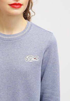 Femme Lacoste LIVE Sweatshirt - light indigo blue bleu chiné: 95,00 € chez Zalando (au 31/05/16). Livraison et retours gratuits et service client gratuit au 0800 740 357.