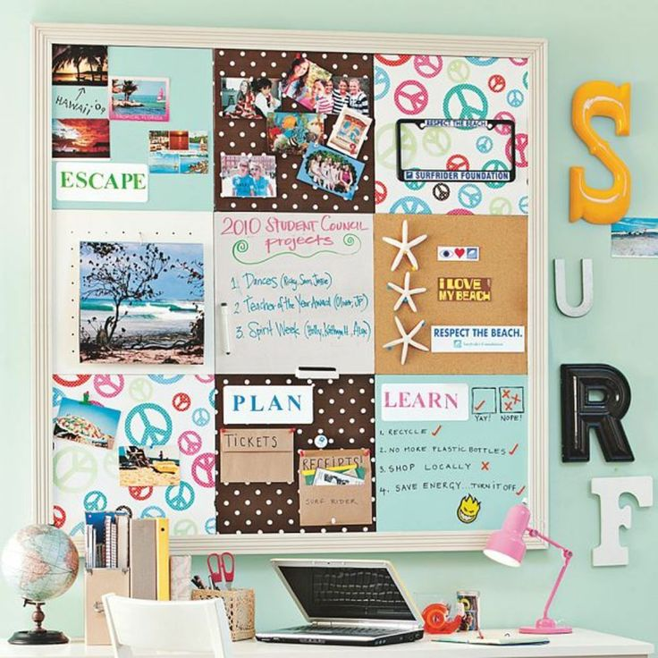 A beach inspired pinboard above a dorm room desk adds College dorm wall decor