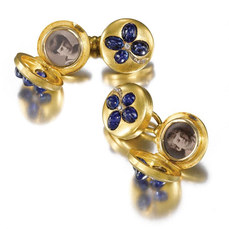 ROMANOV HEIRLOOMS: THE LOST INHERITANCE OF GRAND DUCHESS MARIA PAVLOVNA: A rare pair of jewelled gold locket cufflinks, circa 1883-84 each link set with a cabochon sapphire and circular- and rose-cut diamond four leaf clover, opening to reveal hand-tinted photographs of Grand Dukes Kyrill, Boris and Andrei Vladimirovich and Grand Duchess Elena Vladimirovna.
