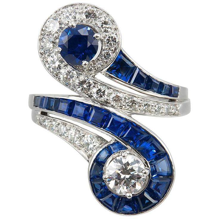 http://rubies.work/0334-sapphire-ring/ Tiffany & Co. Sapphire Diamond Platinum Bypass Ring