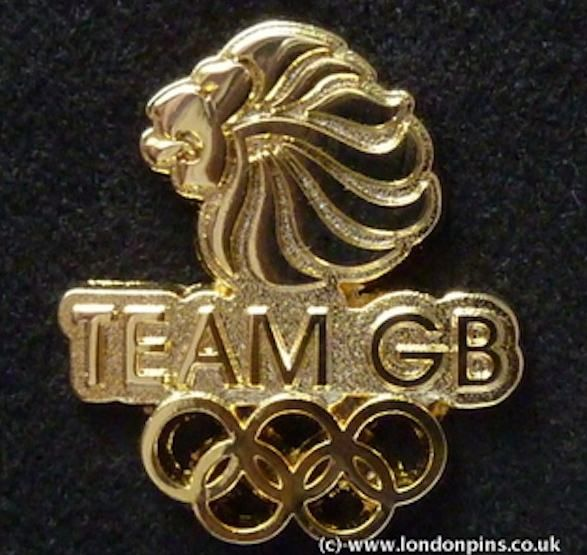 Kate is also wearing her navy skinny jeans, Givenchy sunglasses and carrying a Team GB  jacket and Team GB Olympic pin badge.