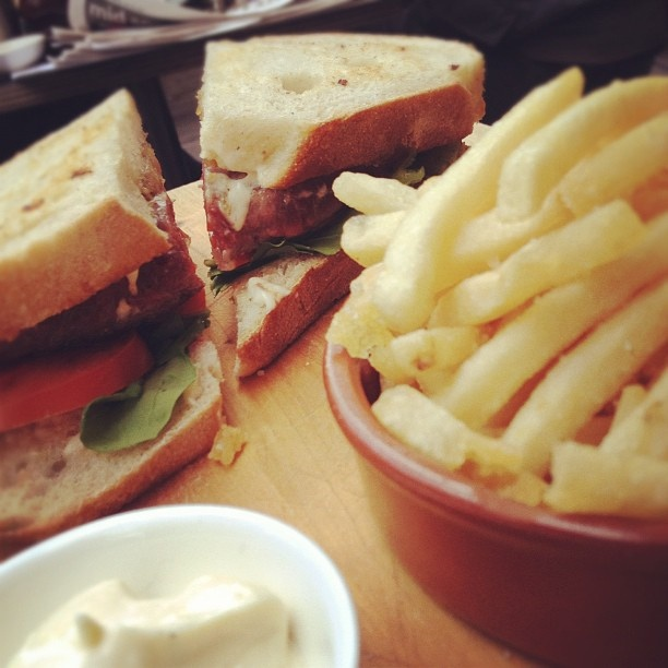 Steak sandwich with caramelised onion, fresh tomato, rocket and fries with house made aioli ~ by Jane Wong