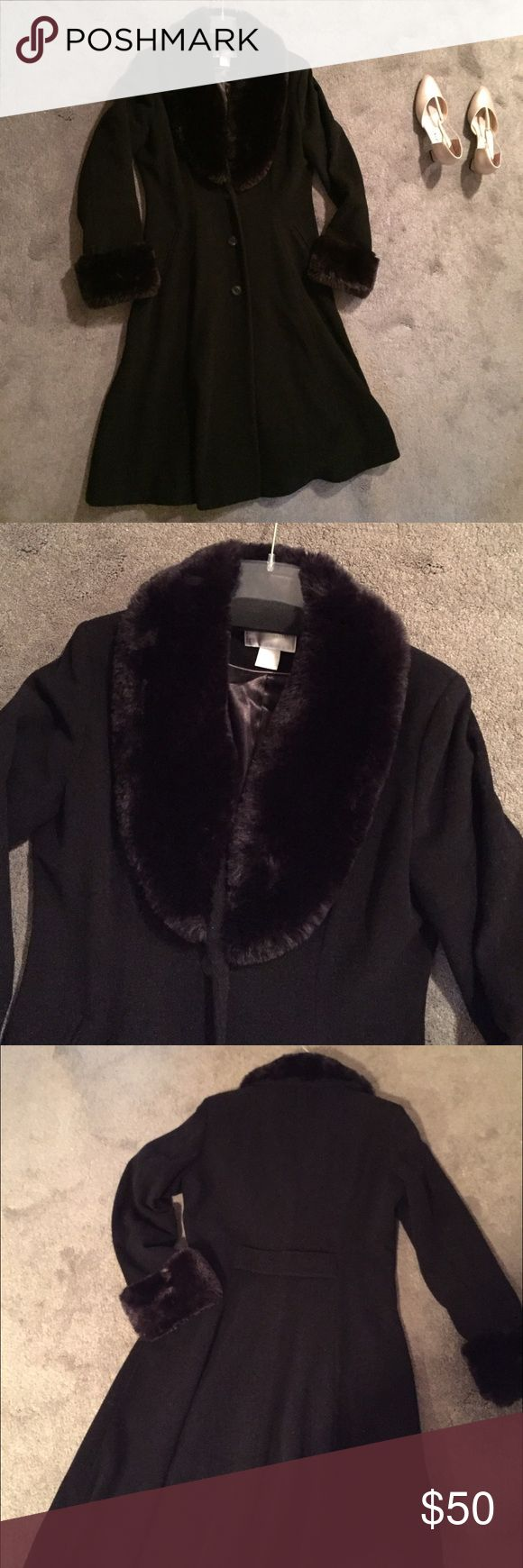 """WOOL COAT W FAUX FUR EUC This fully lined black wool dress coat (in perfect condition) will keep you toasty warm in elegant style! Generous faux soft fur at the neck & sleeves. You'll love the luxurious feel of it! Fitted waist. Gently flows out at the skirt. 3 large black front buttons. 2 functioning slit pockets in front. 48"""" long. Hits below the knee. Faux back belt nips the waist for style. 70% wool, 20% nylon, 10% recycled cashmere. Worthington Jackets & Coats"""