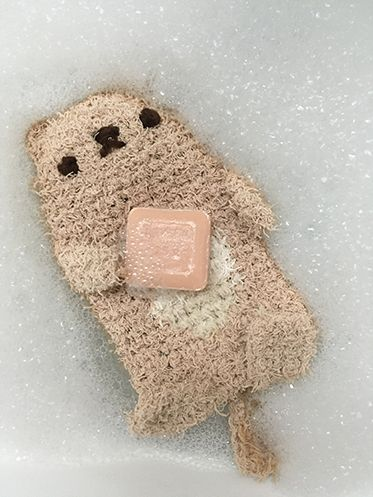 free crochet pattern | otter bath scrubby Super cute! It's made with Red Heart Scrubby yarn in tan and loofa. I definitely want to pick up some and try it out!