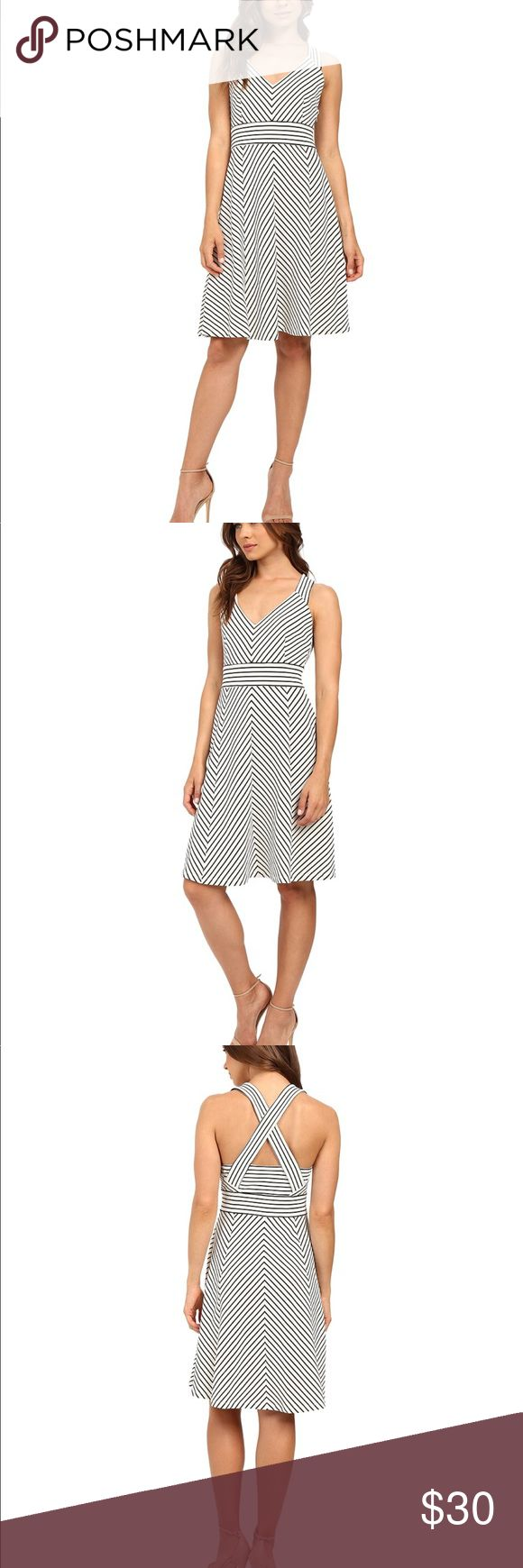Adrianna Papell Striped Ottoman Knit Dress A stunning striped look perfect for summer in the in the city! Sleeveless fit-and-flare dress crafted in an elegant ottoman stretch knit. Strategic seaming creates an allover chevron-stripe pattern. Darting highlights the slim cut at bodice. Halter V-neckline features a cross-back design for an alluring finish. Defined waistline sports a contrast stripe design. Straight hemline hits at a modest length. Side zipper closure. Adrianna Papell Dresses