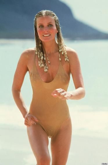 Her appearance in this simple swimsuit and braided cornrows made Derek an overnight sensation. This image also became a best-selling poster.