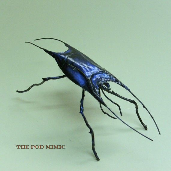 This is a sculpture,  pod mimic beetle