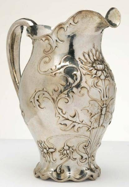 Gorham Sterling Silver Martelé Art Nouveau WaterPitcher  Ca.1899    Art Nouveau flowers, leaves and butterfly decor. Bears company trademarks, 8992, and Spaulding & Co. retail mark.