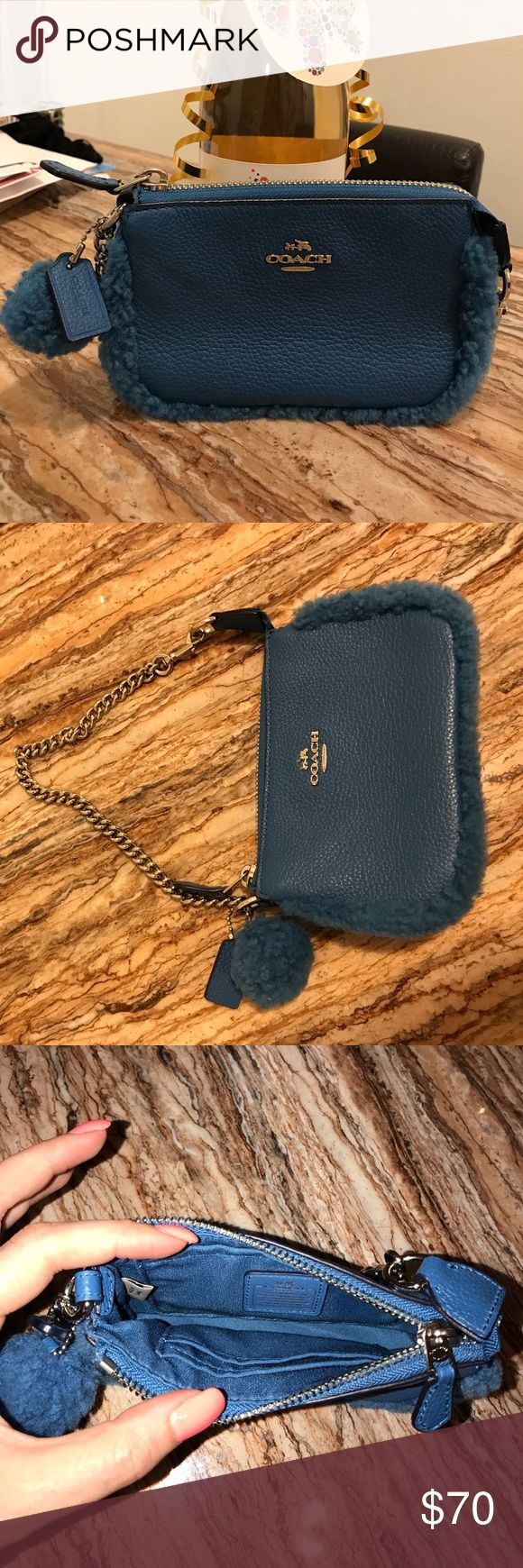✨ Adorable Shearling Peacock Nolita Wristlet ✨ Small Coach bag, never used. Please refer to description in picture for additional detailed information and size pertaining to bag. Please note that a coach box is not included ☺️ let me know if you have any questions Coach Bags Clutches & Wristlets