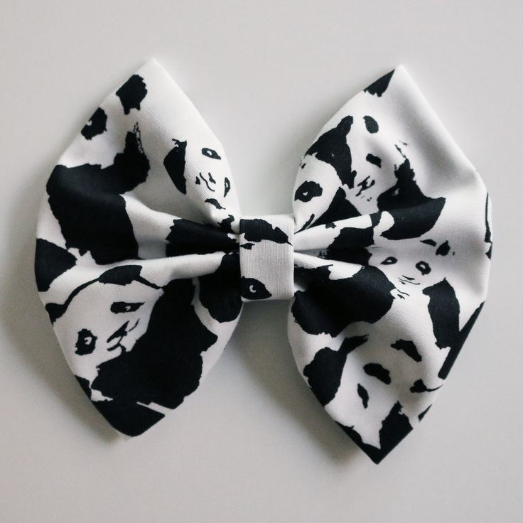 A white and black panda print. Bow is around 4 inches wide.