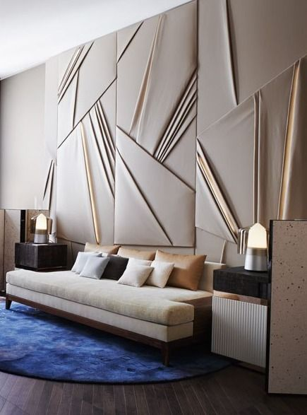 Dramatic wall paneling in this living room in the AD France designer show house.: