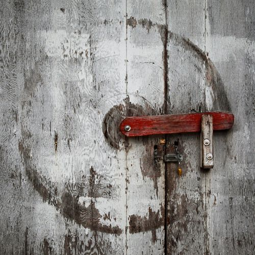 photographybyjustinps:  Etched Over Time A well-worn, wooden storage shed door displays wear and tear associated with decades of use. Taken in Powell River during the Sunday Farmer's Market.
