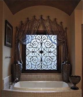 Master bath with metallic color wash barrel ceiling and iridescent sheer drapery using knobs and tableux faux iron
