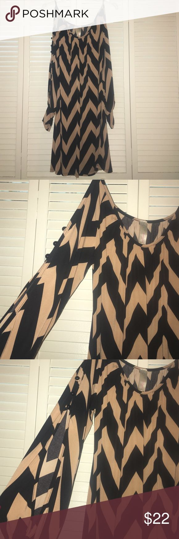 Chevron dress. Navy and tan long sleeve chevron dress with slits down the arms. Dresses Mini