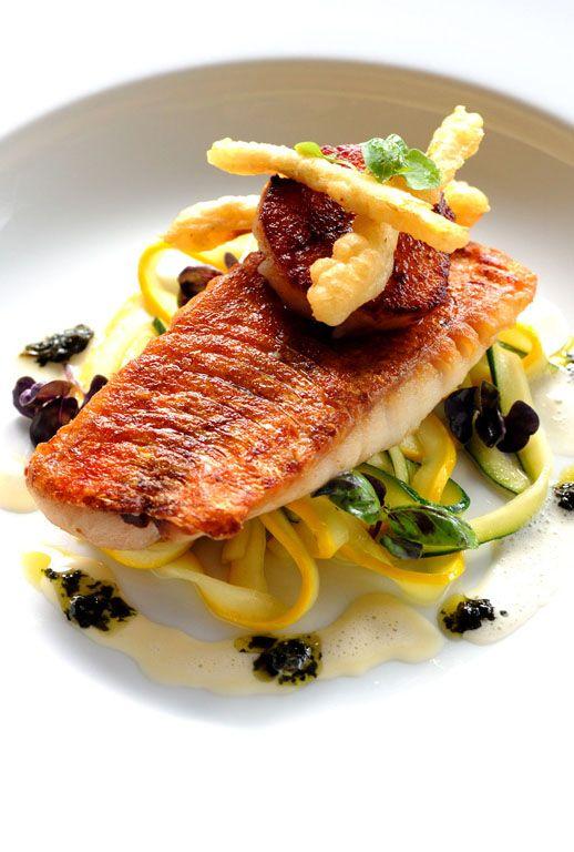 Robert Thompson's red mullet recipe is not what it first seems. Normally associated with pasta, the tagliatelle the mullet fillets and scallops rest on is actually made from ribbons of courgette.