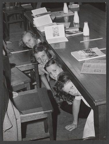 Redfern Primary School, Victoria-  taking shelter under desks ca. 1942