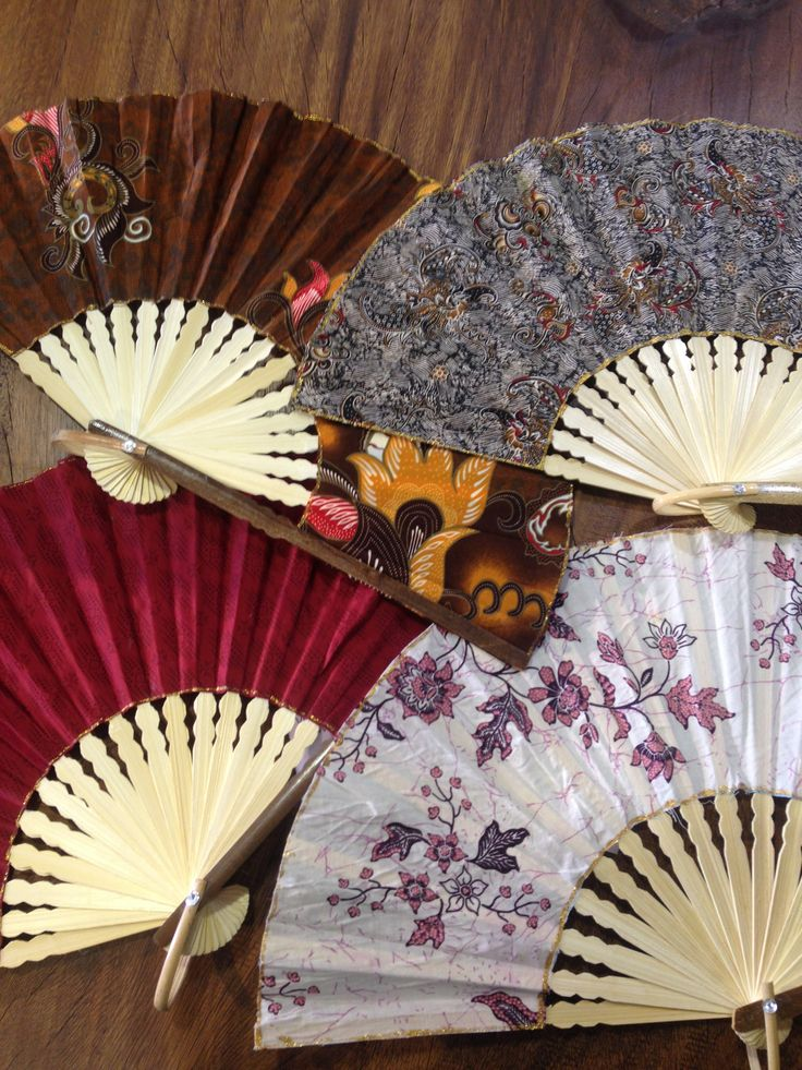 Beautiful Balinese hand fans, we have ten different prints at our 17th avenue location. #yyc #imports #bali #handfans
