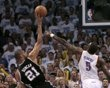 San Antonio Spurs' Duncan tries to shoot over Oklahoma City Thunder's Perkins in the 4th quarter during Game 4 of the NBA Western Conference basketball finals in Oklahoma City