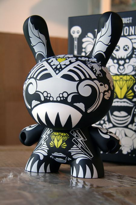 """Dunny.  A Dunny is a type of vinyl designer toy created by Paul Budnitz and Tristan Eaton, and produced by Kidrobot from 2004. The toy is based on a rabbit figure with distinctive tubular ears. The origin of the name Dunny came from a combination of street slang and one of the early """"Devil Bunny"""" prototypes."""