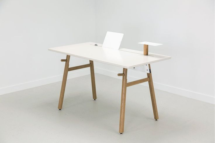 Beautiful minimalist desk made from white oak and steel for lasting durability. Modern, tech-friendly design that assembles in minutes.