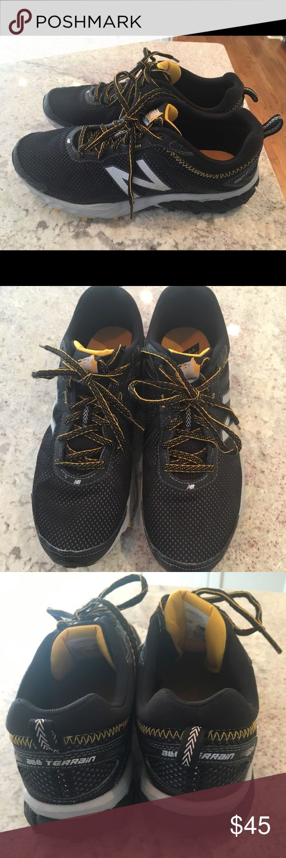 Men's New Balance shoes size 8.5 Men's New Balance all terrain shoes, size 8.5.  Very good condition with minimal wear.  Still look new.  Black, yellow and silver.  Yellow and black shoe strings. New Balance Shoes Sneakers