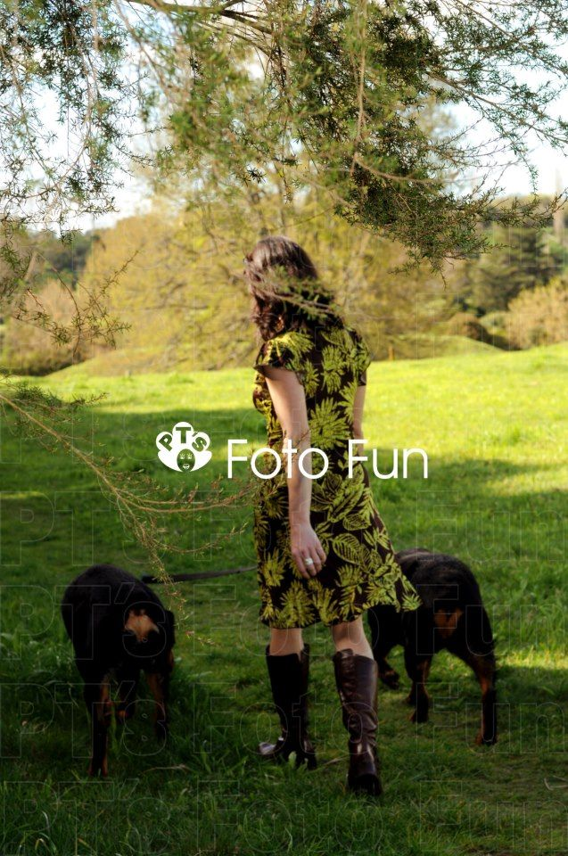 Beautil portrait of woman with her rottweiler dogs