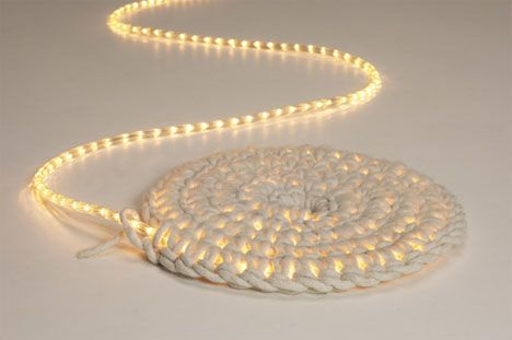 The Light Carpet using a strand of LED lights and knitting from the center. by Johanna Hyrkas