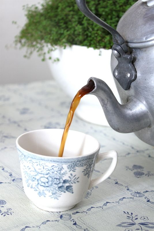 Tea:  A vintage tea kettle and china teacup with a delft-blue floral pattern.