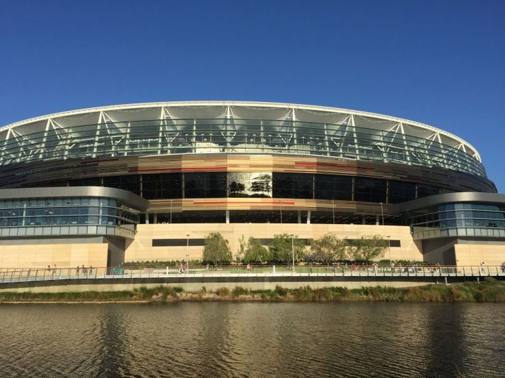 BA2944/6: Close up of western exterior, showing floor to ceiling glass windows of the Riverview rooms, Optus Stadium. https://encore.slwa.wa.gov.au/iii/encore/record/C__Rb5567658