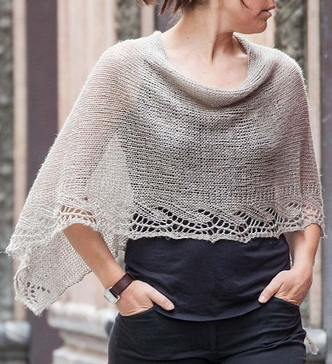 Free Knitting Pattern for Emilia Poncho - This lace edged poncho is knit as a rectangle and seamed. Designed by Emilia Menéndez. Available in English and Spanish.