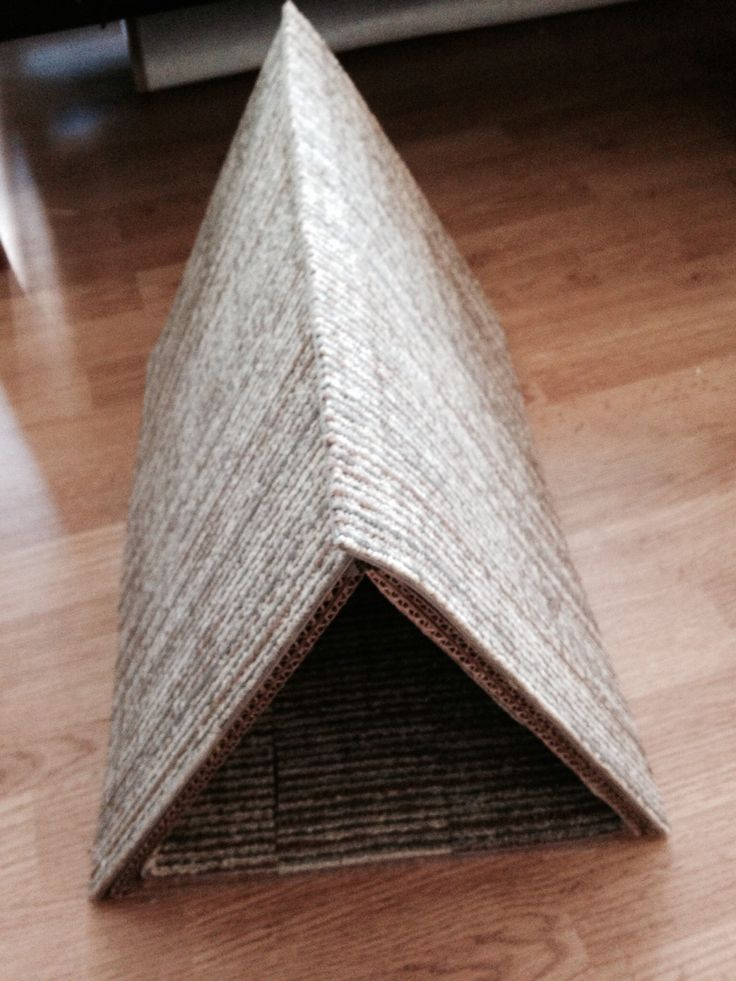 DIY cat scratch post! Total was $2.00! Saves my furniture, cat loves it! Super easy to make. A piece of cardboard, 2 mats from dollar store, and a glue gun.