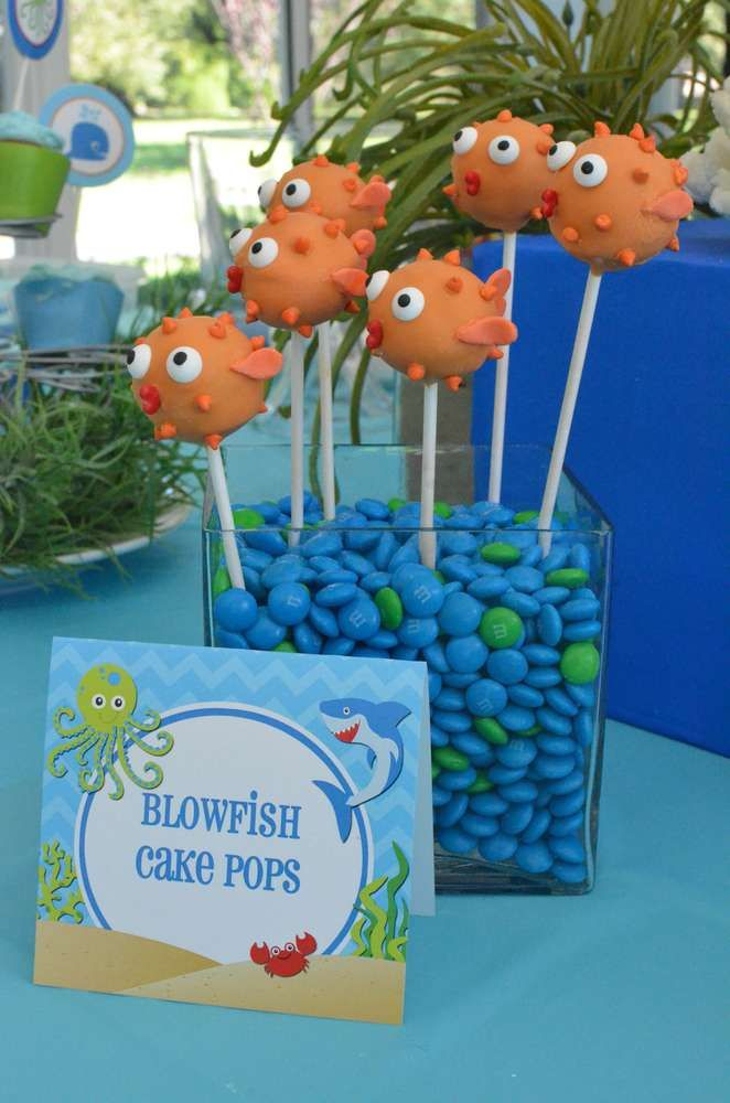 Blowfish cake pops at an under the sea birthday party! See more party planning ideas at CatchMyParty.com!