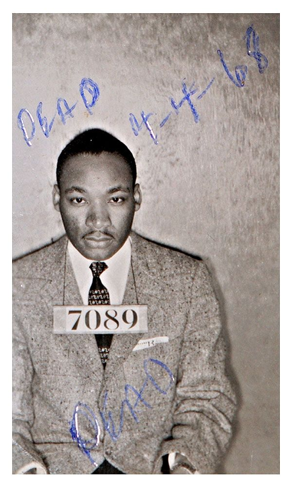 "Martin Luther King, Jr. was photographed by Alabama cops following his February 1956 arrest during the Montgomery bus boycotts. The historic mug shot, taken when King was 27, was discovered in July 2004 by a deputy cleaning out a Montgomery County Sheriff's Department storage room. It is unclear when the notations ""DEAD"" and ""4-4-68"" were written on the"