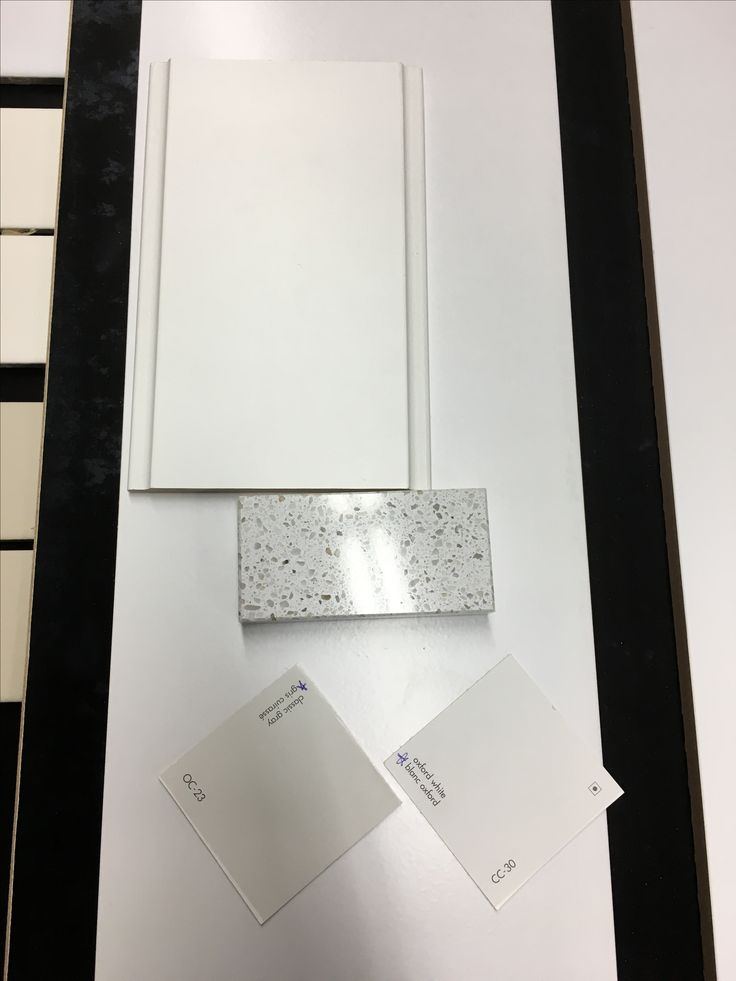 """Large tile under samples:  tile """"trim"""" for around bathtubs - Tierra Sol Contract White Matte in 4x16"""" along with Mapei grout in Frost"""
