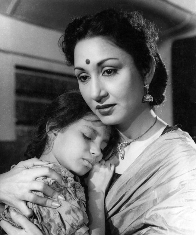 Lobby card in the movie 'Boot Polish', 1954. Lobby card depicting actresses Kumari Naaz and Chand Burke playing Belu and Kamala respectively, in the film 'Boot Polish' (dir. Prakash Arora, 1954). The actors are shown in an embrace here, although in the story Kamala was a cruel aunt to Belu and her brother Bhola. The film portrays the strength of the love of siblings, in the face of abject poverty and social cruelty. Produced by Raj Kapoor, the film won several Filmfare awards, including…