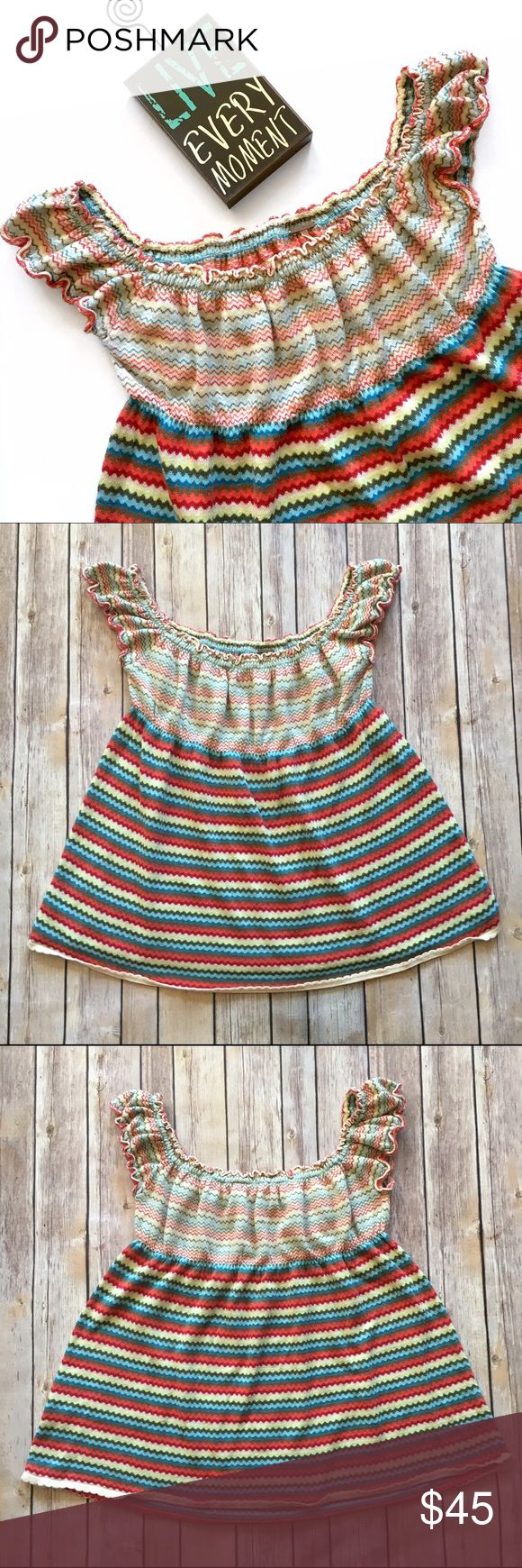 Free People Smocked Multicolored Zigzag Stripe Top Adorable boho chic smocked babydoll top! Multicolor zigzag stripes. Would look cute worn regular or off the shoulder! 2 teeny tiny pulls (last pic) otherwise excellent pre-loved condition!   🚫no trades 🚫no modeling ✅dog friendly/🚭smoke free home ✅reasonable offers ✅bundle & save! Free People Tops Blouses