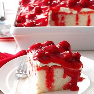 "Cherry Dream Cake Recipe -""I serve this at Christmas because it's so festive,"" Margaret McNeil says of her crowd-pleasing cake. The Germantown, Tennessee baker uses cherry gelatin to give a boxed cake mix an eye-appealing marbled effect."